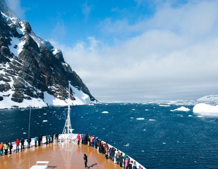 Cruise ship in the waters of Antarctica between mountains and ices