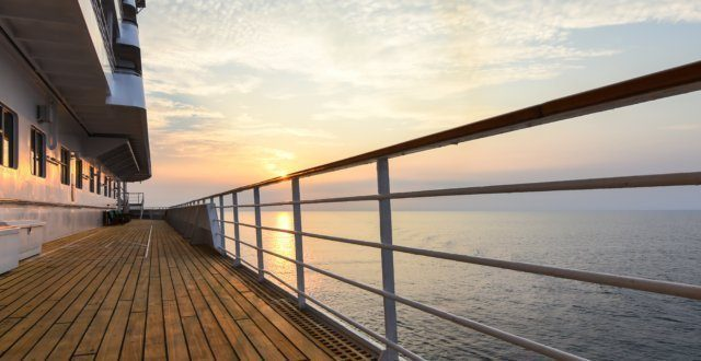 Cruise ship deck with beautiful sunset.