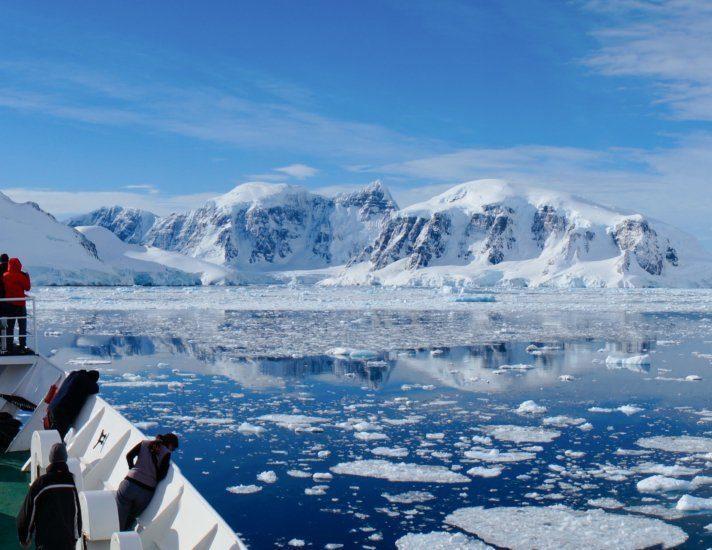 Cruising through the Neumayer channel full of Icebergs in Antarctica.