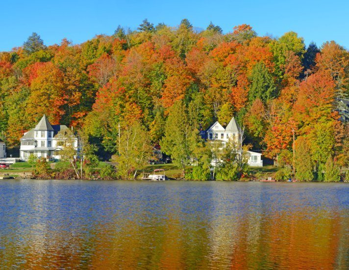 Fall foliage and reflection in Saranac Lake, New York